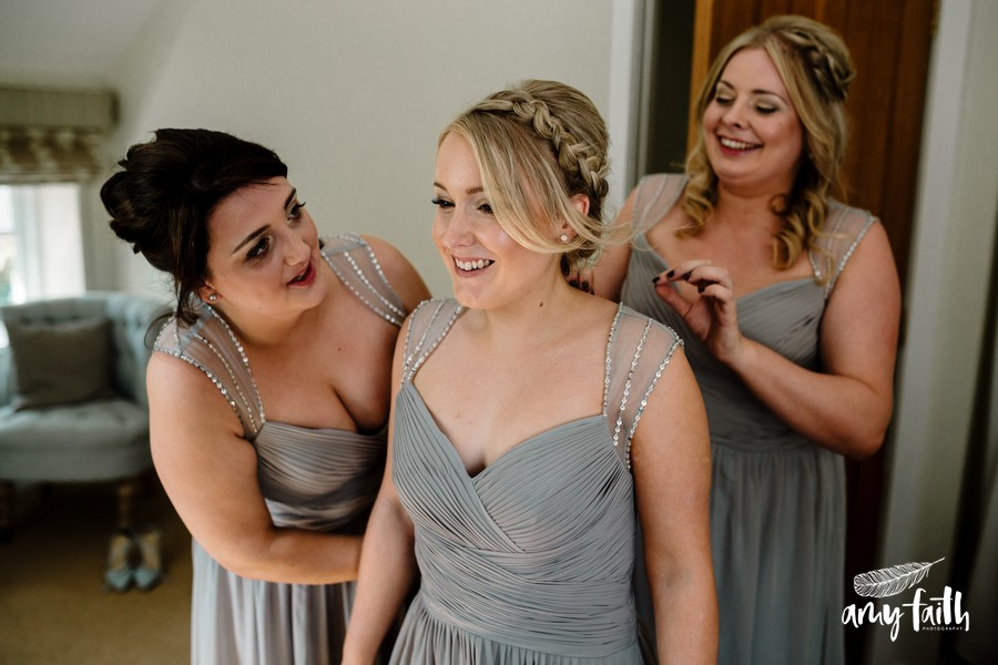 bridesmaids smiling in grey dresses