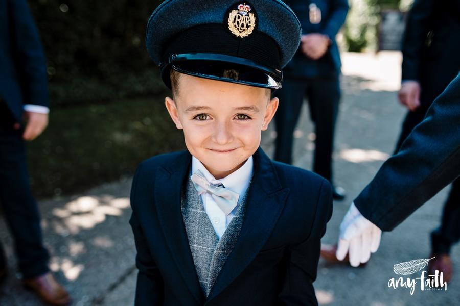 creative documentary wedding photographer little boy in blue soldier hat