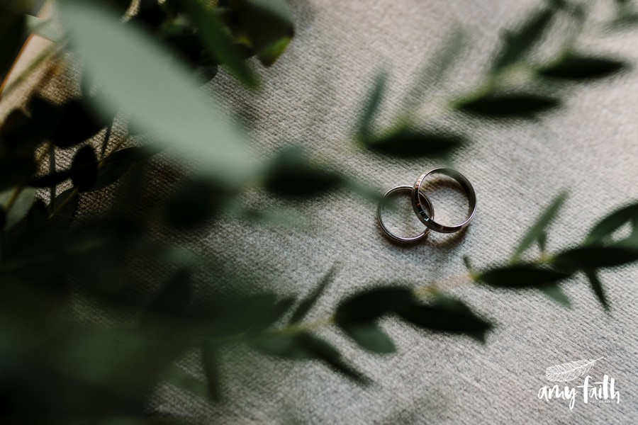 green foliage bouquet and wedding rings
