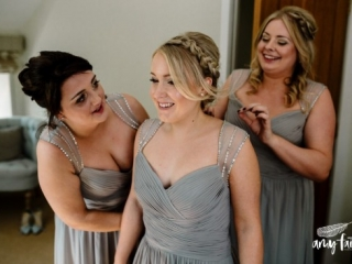 bridesmaids smiling in grey dresses