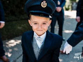 creative documentary wedding photographer little boy in blue soldier hat