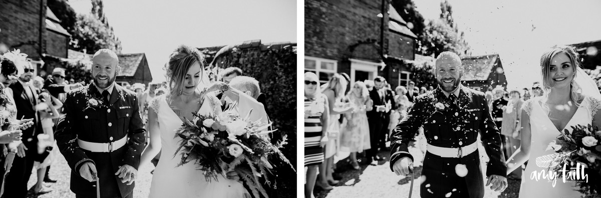 Bride and groom having confetti thrown at them and put down the brides wedding dress