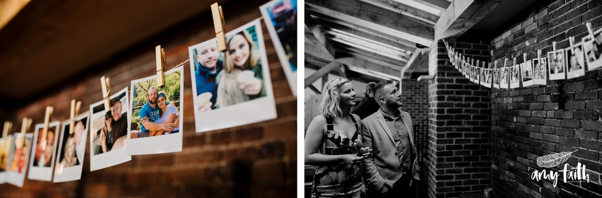 Polaroids of couple pegged onto string hung in converted barn wedding venue against brick wall