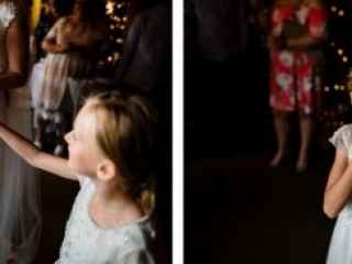 Little girl being given and eating wedding cake