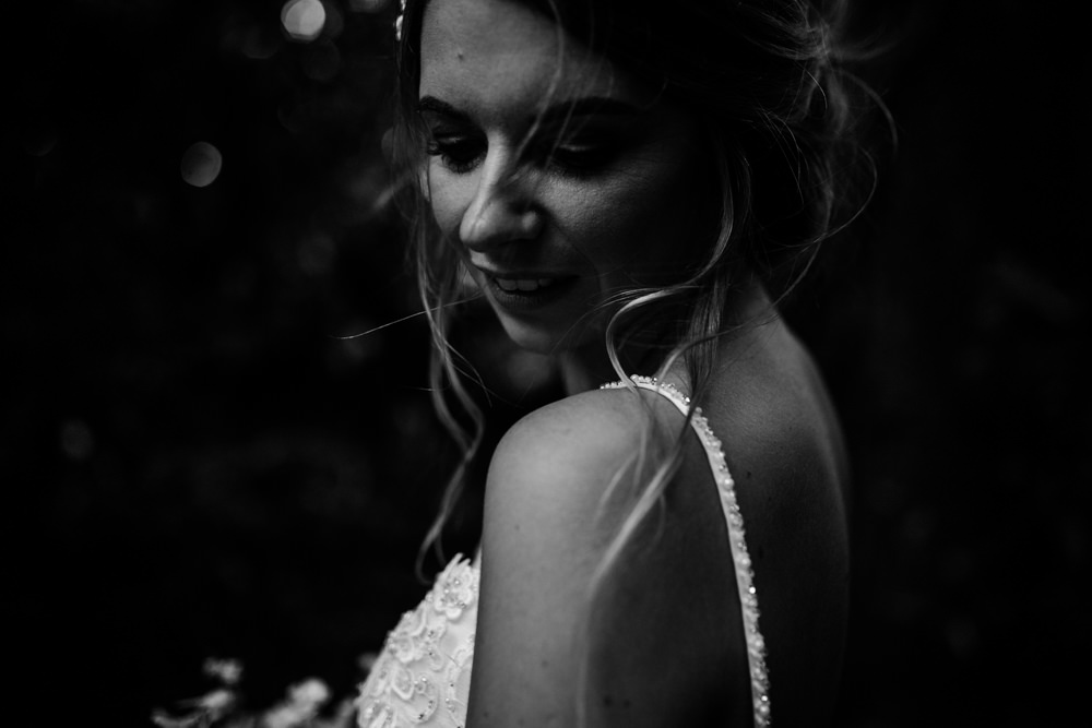 A black and white close up portrait of a bride.