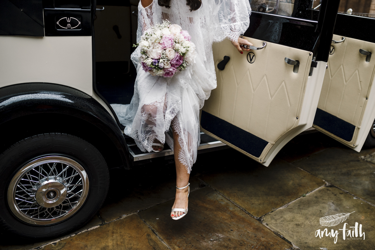 A bride stepping out of a car.
