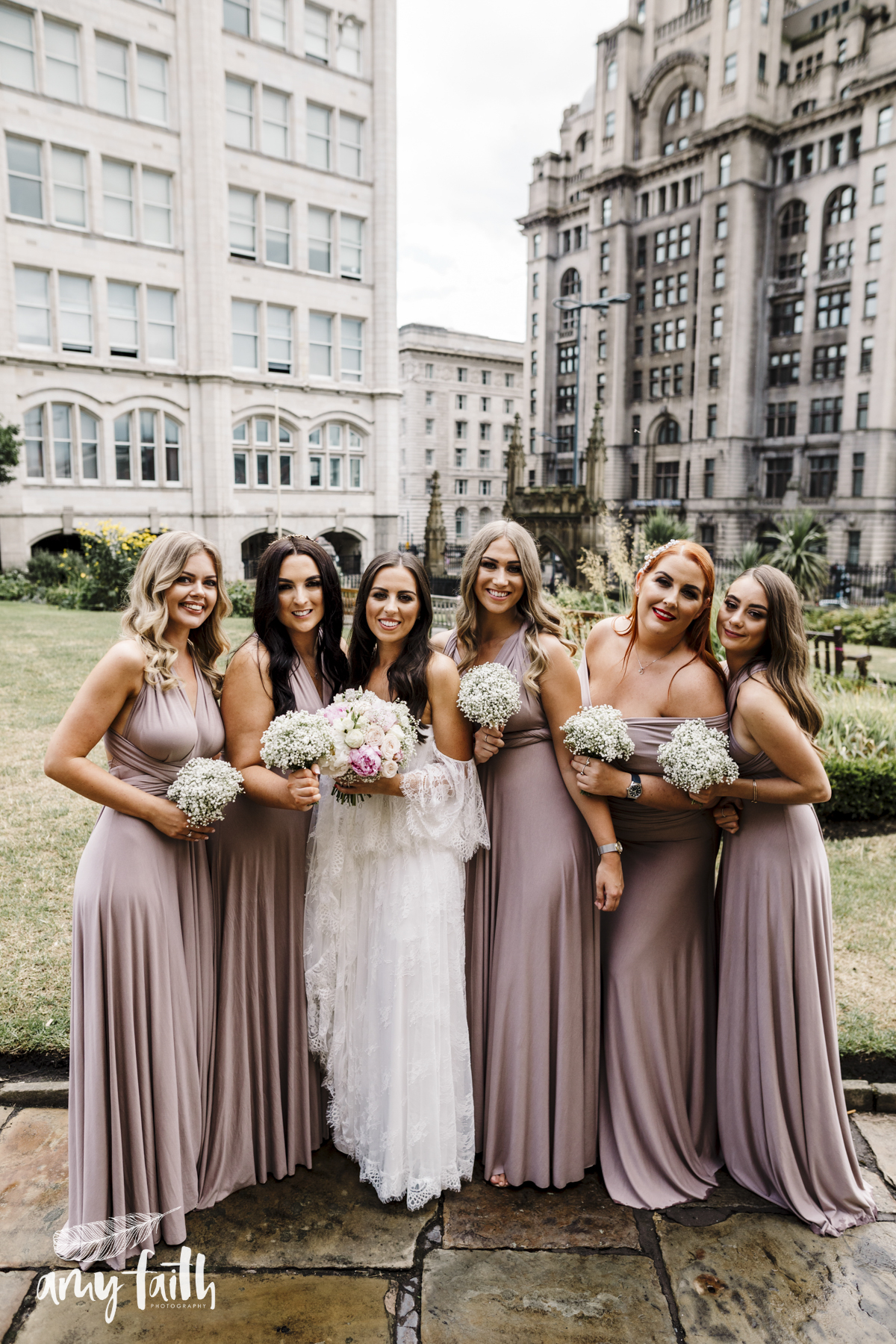 Bridesmaids in dusky pink dresses.