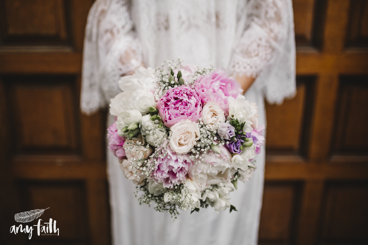 A bride holding a bouquet.