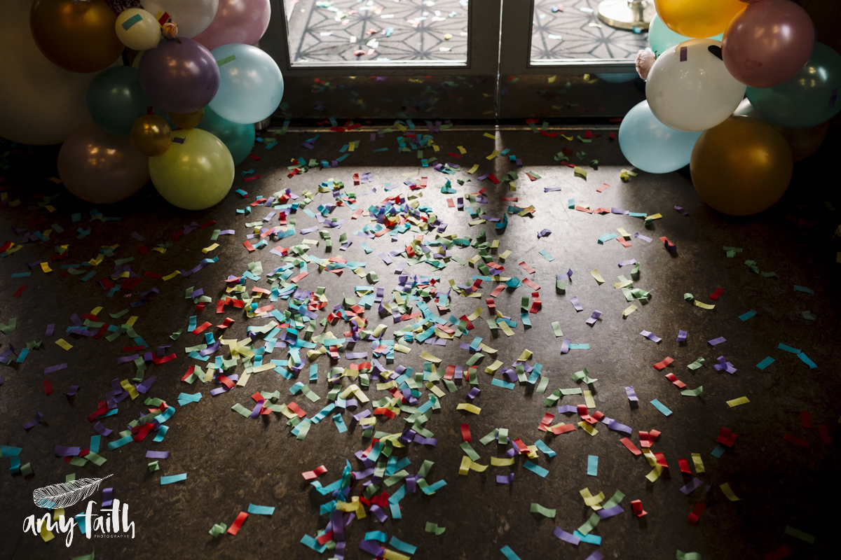 Colourful confetti on the floor.
